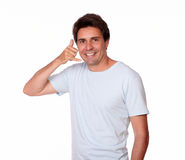 Smiling guy gesturing call me with one hand Stock Photography