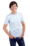 Smiling guy with hands in pockets Stock Photography