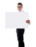Smiling guy holding banner ad with one hand Royalty Free Stock Image