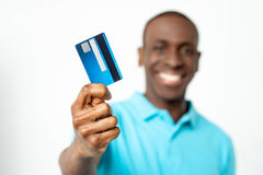 Smiling guy holding credit card Stock Photography