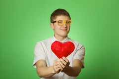 Smiling guy holding heart shape Stock Photography