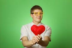Smiling Guy Holding Heart Shape Stock Photography