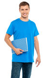 Smiling guy holding spiral notebook Stock Photos