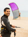 Smiling guy with kiteboardon at the beach Royalty Free Stock Images