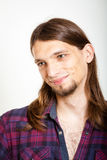 Smiling guy with long hairs. Masculinity concept. Smiling guy with long hairs. Young man in plaid shirt Royalty Free Stock Photos