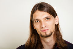 Smiling guy with long hairs. Masculinity concept. Smiling guy with long hairs. Young man in plaid shirt Stock Image