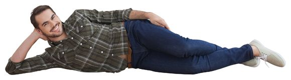 Smiling guy lying down with white background Stock Photos