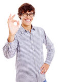 Smiling guy with ok symbol. Cheerful latin young man showing ok sign. Isolated on white background, mask included Royalty Free Stock Image
