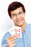 Smiling guy with playing cards Royalty Free Stock Photo