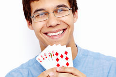 Smiling guy with playing cards Royalty Free Stock Photography