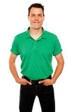 Smiling guy posing with hands in jeans pocket Stock Images