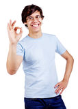 Smiling guy showing OK sign Stock Photos