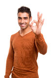 Smiling guy showing Ok sign Stock Images