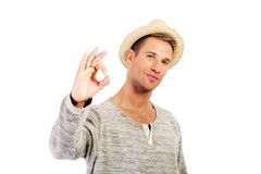 Smiling guy showing Ok sign Stock Photo