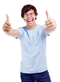 Smiling guy showing thumb up Royalty Free Stock Images
