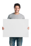 Smiling guy with sign Royalty Free Stock Images