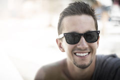 Smiling guy in sunglasses. Royalty Free Stock Image