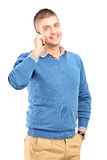 Smiling guy talking on a mobile phone Royalty Free Stock Photo