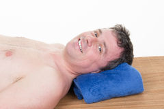 Smiling guy waiting for massage in spa center Royalty Free Stock Images