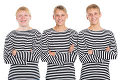 Smiling guys in a striped shirt with arms crossed Royalty Free Stock Photography