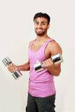Smiling gym trainer Stock Photography