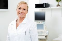 Smiling Gynecologist With Ultrasound Machine Stock Photo