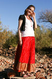 Smiling gypsy 2. Woman standing on a rock smiling and looking at the camera Stock Photography
