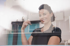 Smiling hairdresser holding hair scissors Stock Photo