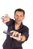 Smiling hairdresser working with scissors and comb. Smiling young hairdresser working with scissors and comb Stock Photo