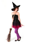 Smiling halloween witch with a broom Royalty Free Stock Photos