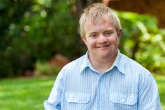 Smiling handicapped boy outdoors. Royalty Free Stock Images