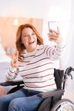 Smiling handicapped woman taking selfies Stock Images