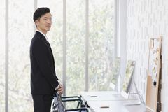 Asian Businessman standing and posing in office royalty free stock images