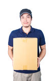 Smiling handsome asian delivery man giving and carrying parcel o Stock Photos