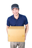 Smiling handsome asian delivery man giving and carrying parcel o Royalty Free Stock Photography
