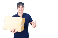 Smiling handsome asian delivery man giving and carrying parcel o Royalty Free Stock Image