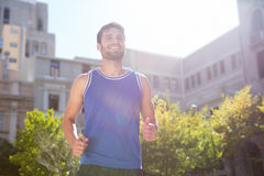 Smiling handsome athlete jogging Royalty Free Stock Photo