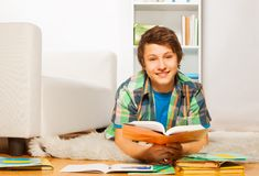 Smiling handsome boy do homework at home Royalty Free Stock Images