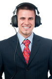 Smiling handsome businessman listening to music Royalty Free Stock Photo