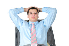 Smiling, handsome businessman. Seating on chair. Royalty Free Stock Photography