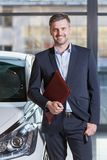Smiling handsome car agent Royalty Free Stock Images