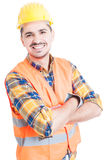 Smiling handsome constructor with folded arms looking cheerful Stock Photography