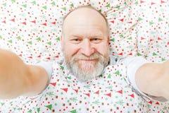 Smiling handsome elderly man Stock Photos