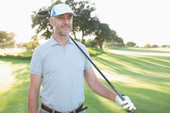 Smiling handsome golfer looking ahead Stock Photo