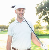 Smiling handsome golfer looking away Stock Photography