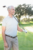 Smiling handsome golfer looking away Stock Image