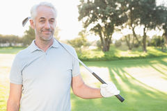 Smiling handsome golfer looking at camera Stock Images