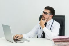 Handsome man sitting use computer In his office. Stock Photography
