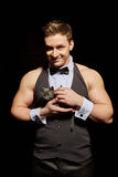 Smiling handsome male dancer palming kitten Royalty Free Stock Images