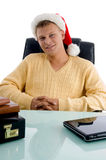 Smiling handsome male with santa hat Royalty Free Stock Images